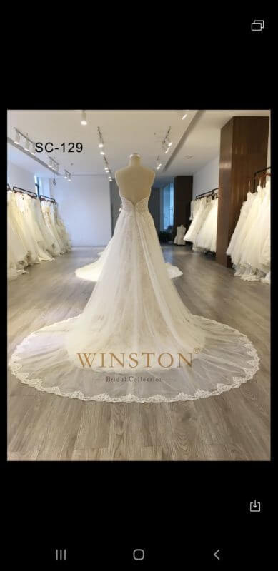 2 piece lace strapless modified mermaid wedding gown w/over skirt