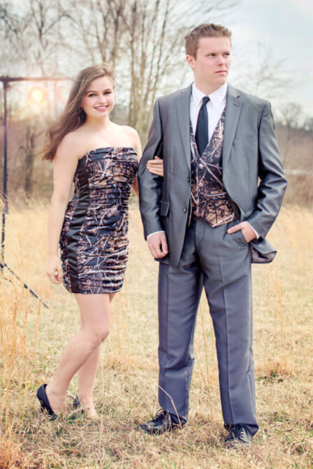 Short camo prom dress and man wearing camo vest